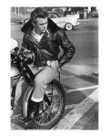 ames Dean sitting on wheel with a leather jacket